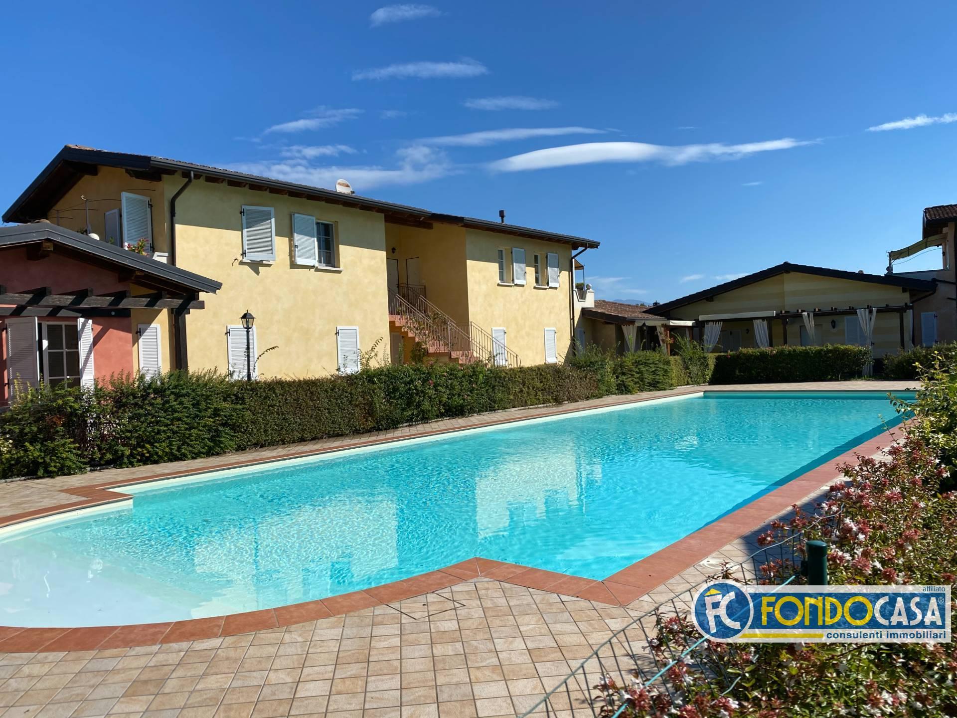 Appartamento in vendita a Manerba del Garda, 3 locali, zona Zona: Sorarolo, prezzo € 209.800 | CambioCasa.it